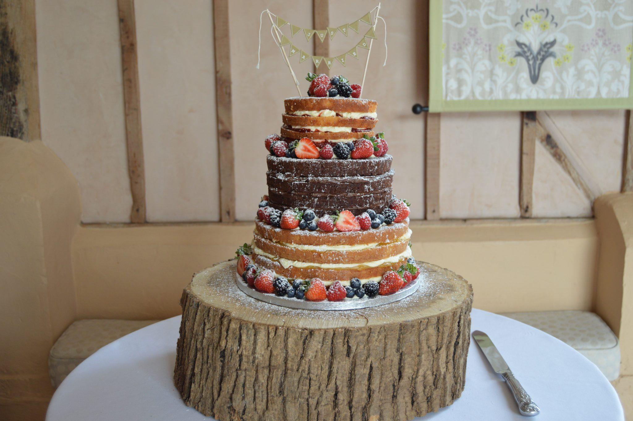 Naked wedding cake with fresh berries, Upwaltham Barns