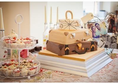 Travel inspired suitcase wedding cake