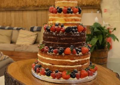 4 tier 'naked' wedding cake decorated with fresh fruit