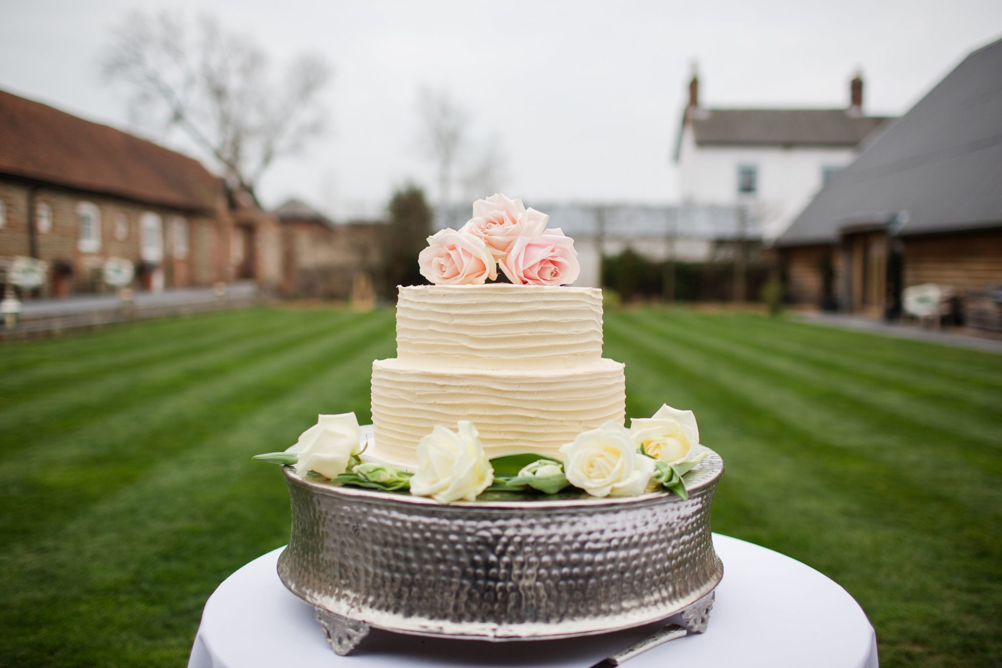 Nic's Slice of Heaven two tier buttercream wedding cake with pale roses, Southend Barns, Sussex