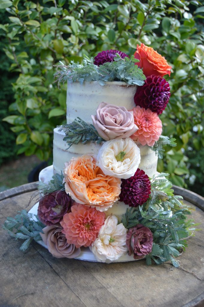 Nic's Slice of Heaven three tier buttercream wedding cake with fresh flowers, Rumbold's Farm, Sussex