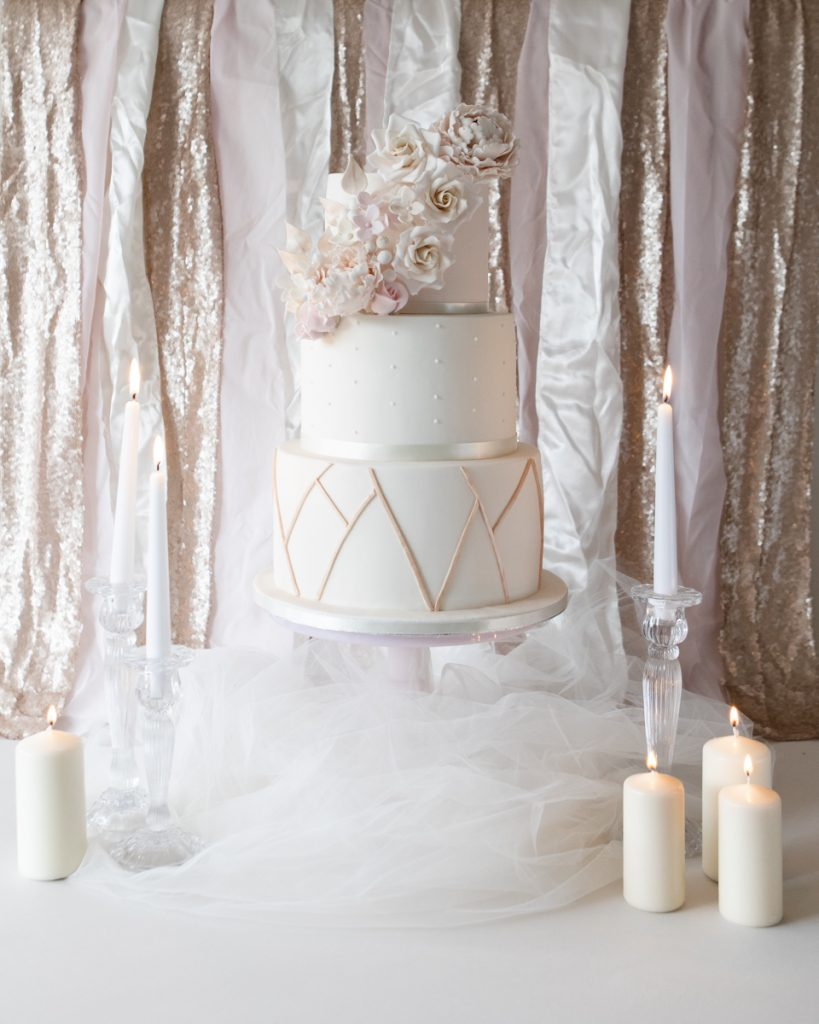 Nic's Slice of Heaven geometeric rose gold and blush pink wedding cake with sugar roses and peonies