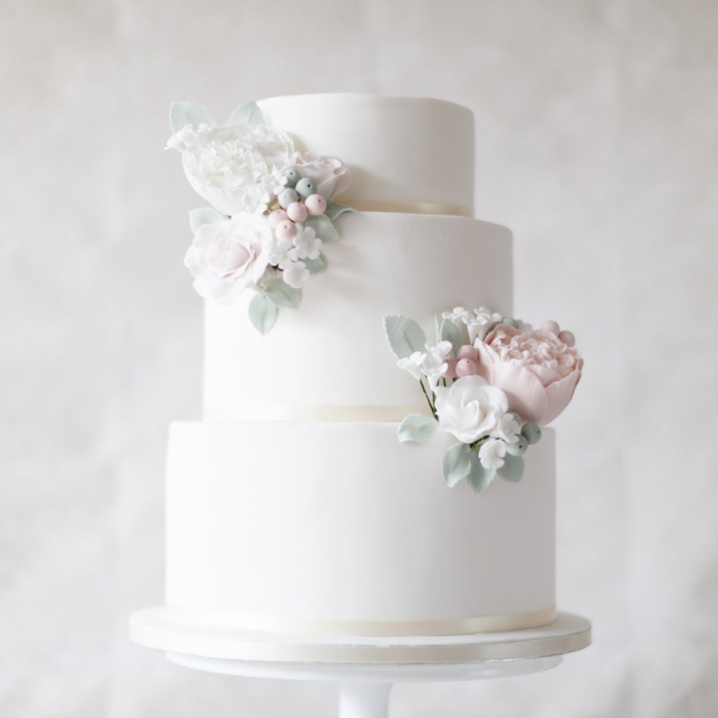 Nic's Slice of heaven white three tier wedding cake with blush pink sugar peonies and roses